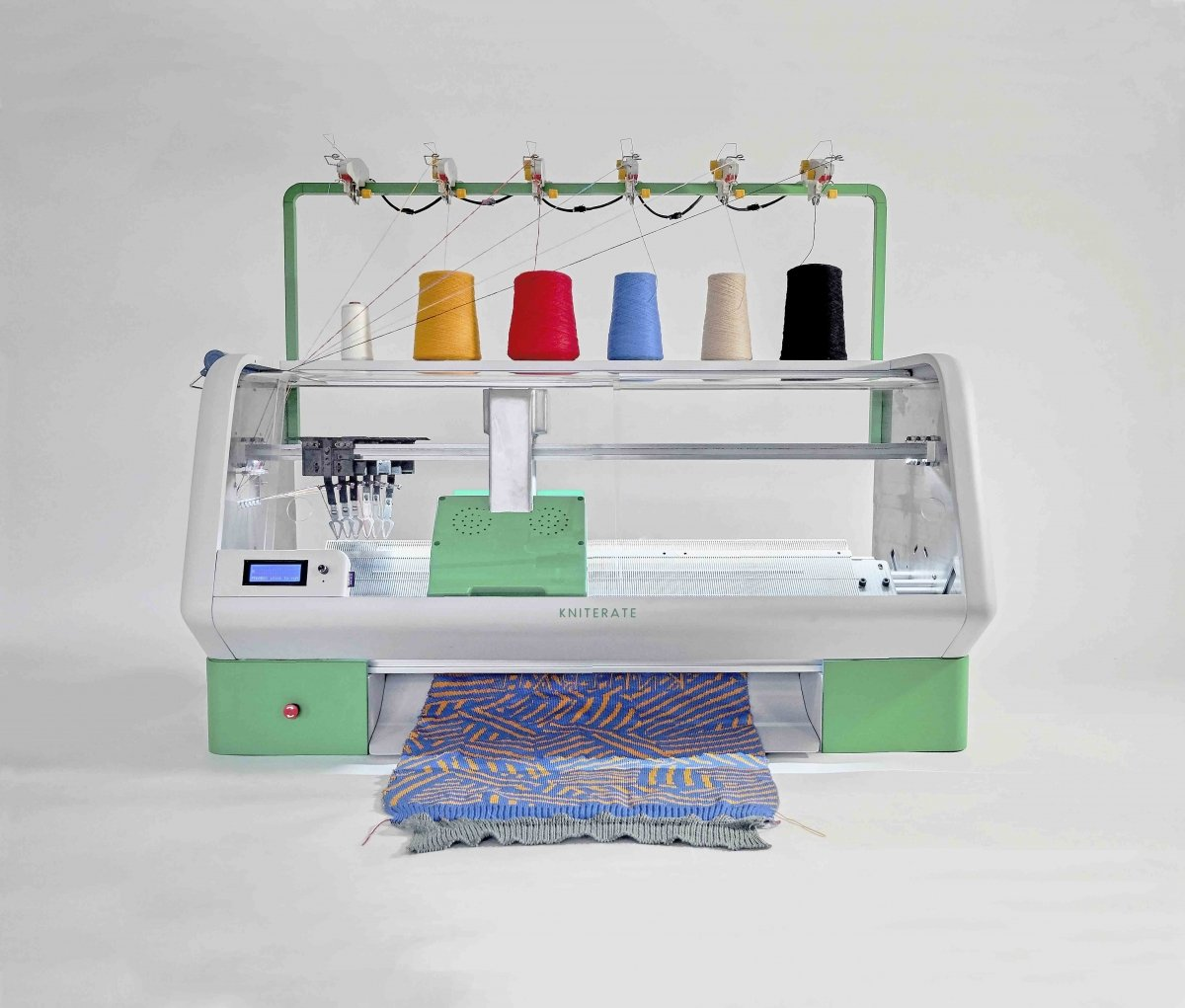 Sustainable textile startup Kniterate has produced a compact knitting machine for communities.
