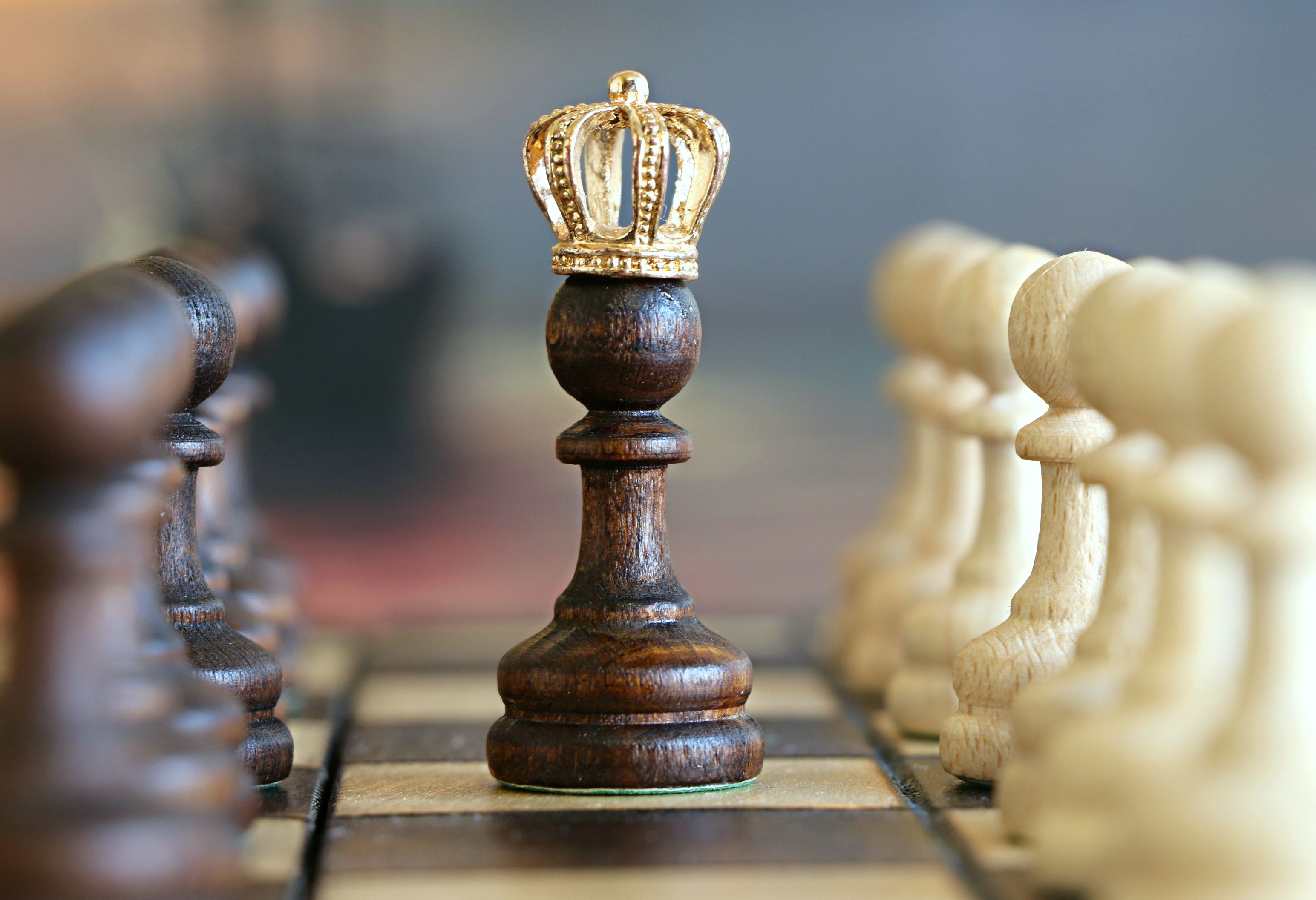 queen-crown-on-chess-pawn